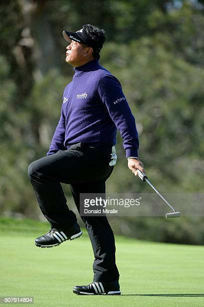 J Choi of South Korea reacts after a missed putt on the 13th green during the final round of the Farmers Insurance Open at Torrey Pines South on...