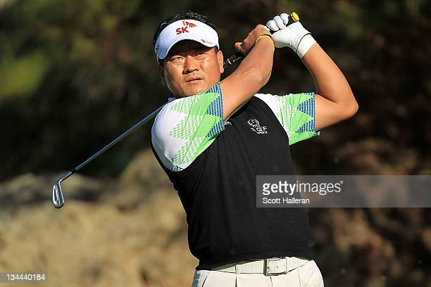 J Choi of South Korea watches his tee shot on the 15th hole during the first round of the Chevron World Challenge at Sherwood Country Club on...