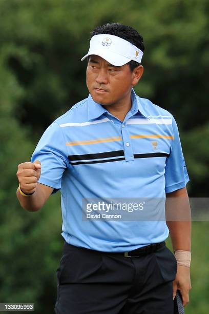 J Choi of the International Team celebrates their 76 win on the 12th hole during the Day One Foursome Matches of the 2011 Presidents Cup at Royal...