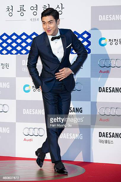 Choi SiWon of South Korean boy band Super Junior attends The 35th Blue Dragon Film Awards at Sejong Center on December 17 2014 in Seoul South Korea