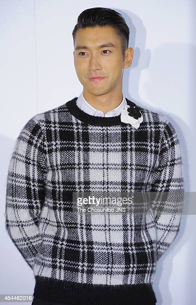 Choi Siwon of Super Junior poses for photographs during the Culture Chanel 'The Sense of Places' opening event at DDP on August 29 2014 in Seoul...