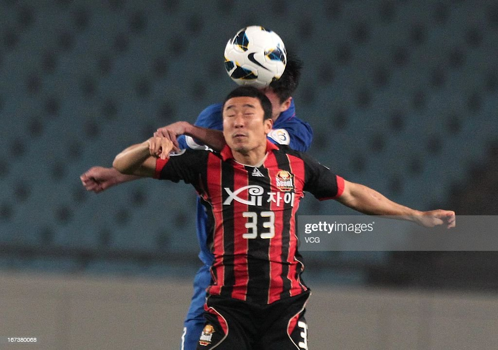 Choi Tae-Uk #33 of FC Seoul jumps to head the ball during the AFC Champions League match between Jiangsu Sainty and FC Seoul at Nanjing Olympic Sports Center Stadium on April 24, 2013 in Nanjing, China.