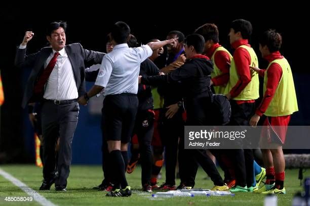 Choi Yong Soo coach of FC Seoul celebrates a goal with teammates during the AFC Asian Champions League match between the Central Coast Mariners and...