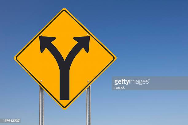 Choice Ahead Division Traffic Sign on Blue Sky Background