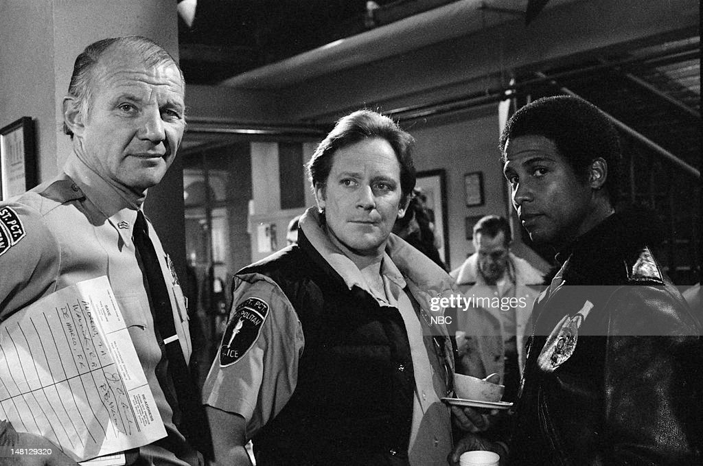 BLUES -- 'Choice Cut' Episode 107 -- Pictured: (l-r) Michael Conrad as Sgt. Phil Esterhaus, Charles Haid as Officer Andy Renko, Michael Warren as Officer Bobby Hill --