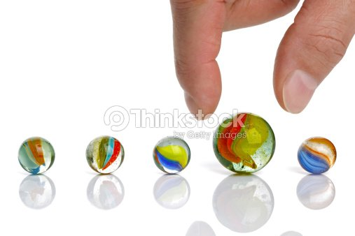 Choice of marbles in different colors : Stock Photo