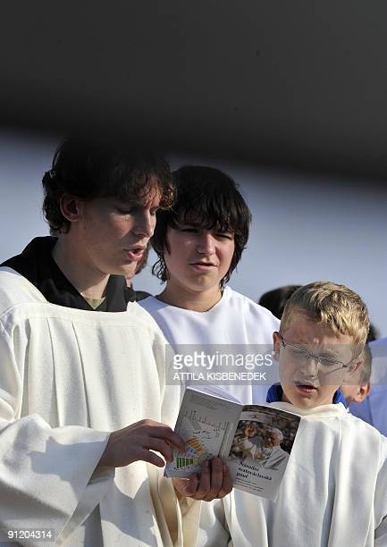 Choir boys sing as they wait for Pope Benedict XVI to celebrate on September 28 2009 an openair mass for the country's youths in Stara Bolesav just...