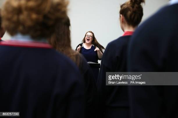 Choir director for Wesley College chamber choir Aine Balfe takes her students through a warm up during Feis Ceoil 2014 at the RDS Dublin