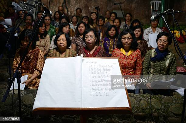 A choir group accompanies the service on 'Sweet Friday pilgrimage' in Puh Sarang Church Sweet Friday Pilgrimage or 'Jumat Legi' is a regular ritual...