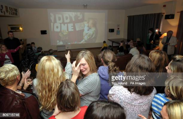 Choir member Ali Taylor sheds a tear with members of the Military Wives Choir at RMB Chivenor in Devon as they watch Top of the Pops where their...