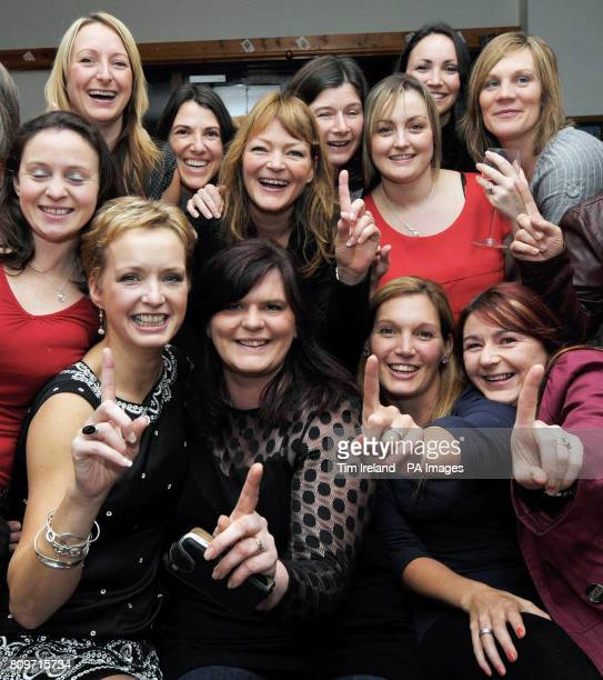 Choir member Emma HanlonPenny with members of the Military Wives Choir at RMB Chivenor in Devon takes a phone call from Decca Records confirming that...