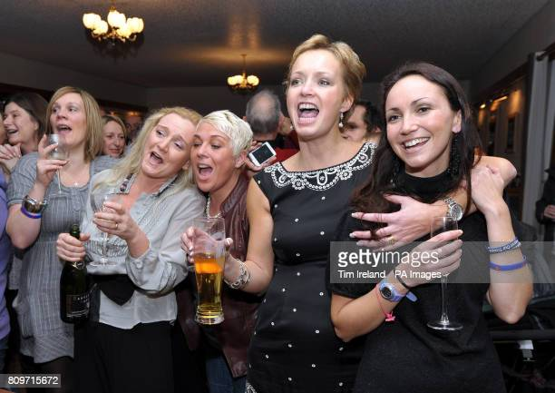 Choir members Jozy Penrose and Joanne Woodward with members of the Military Wives Choir at RMB Chivenor in Devon watching their number 1 single on...