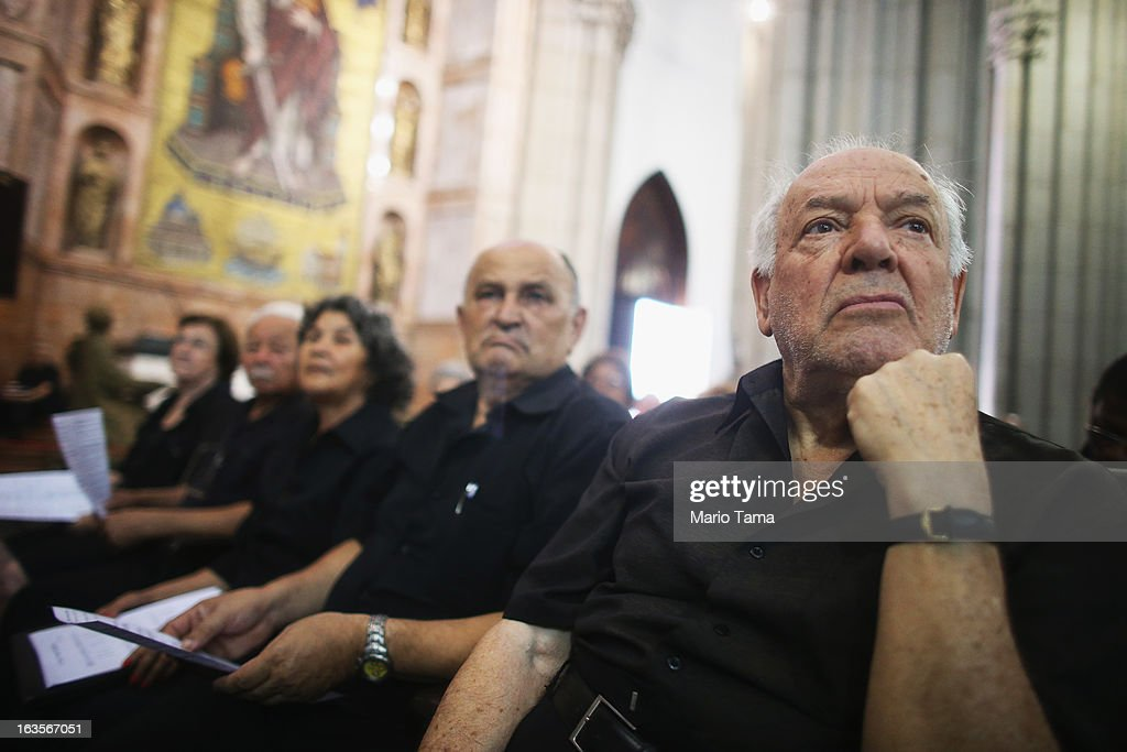 Choir members look on during Mass at the Se Cathedral, the cathedral of the Roman Catholic Archbishop of Sao Paulo, Cardinal Odilo Pedro Scherer, on March 12, 2013 in Sao Paulo, Brazil. Brazil has more Catholics than any other country in the world and supporters hope Scherer will be chosen as the next Pope during the papal conclave.