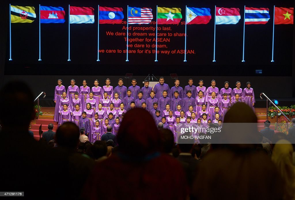 A choir of students sing the anthem of the Association of Southeast Asian Nations during the opening ceremony of the 26th ASEAN Summit in Kuala...