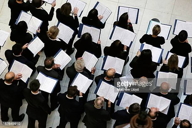 A choir sings as brokers and underwriters line the balconies and escalators of the Lloyd's of London building during a service on November 11 2013 in...