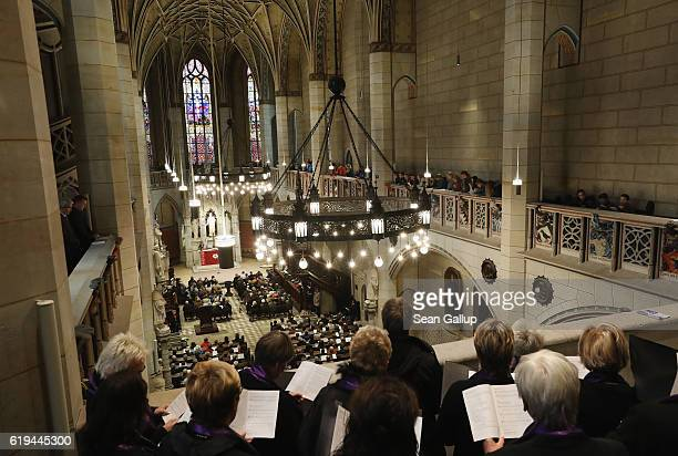 A choir sings as churchgoers attend a Protestant service at the Schlosskirche church to commemorate the 499th anniversary of theologian Martin...