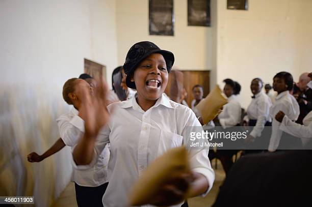 A choir sings at a memorial service for former President Nelson Mandela in his birth village also called the Mvezo Komkhulu or 'great place' December...