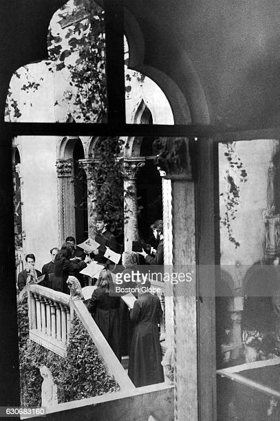 A choir sings Easter hymns from a balcony overlooking the courtyard at the Isabella Stewart Gardner Museum in Boston as part of a memorial birthday...