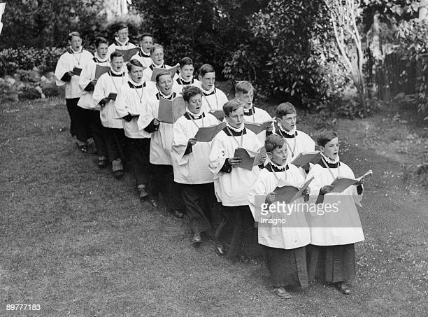 Choirboys rehearse for the church music festival England Photograph Around 1930
