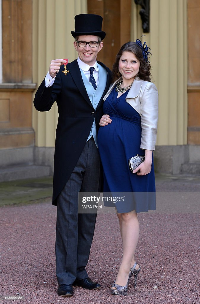 Choirmaster Gareth Malone and his wife Rebecca at Buckingham Palace where he received an OBE during an investiture ceremony on March 12, 2013 in London, England.