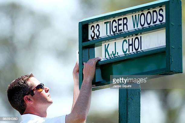 J Choi's name is added to a standard under the name of Tiger Woods during the final round of the 2010 Masters Tournament at Augusta National Golf...