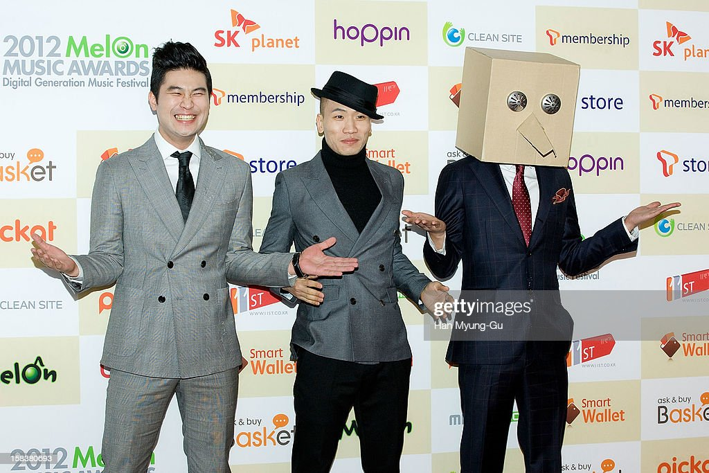 Choiza and Gaeko of South Korean hip hop band Dynamic Duo arrive at the 2012 Melon Music Awards at Olympic Gymnasium on December 14, 2012 in Seoul, South Korea.