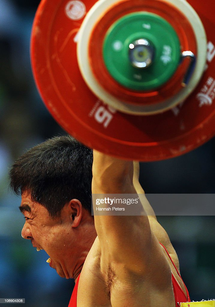 Chol Kum Pang of Korea competes in the Men's Weightlifting 77kg competition during day four of the 16th Asian Games Guangzhou 2010 at Dongguan Gymnasium on November 16, 2010 in Guangzhou, China.
