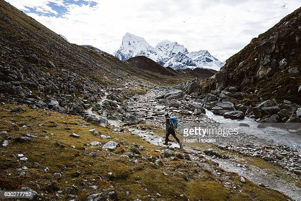 Cholatse and Taboche viewed from the trail out of Gokyo a popular trekking area with many beautiful lakes surrounded by huge peaks Everest views are...