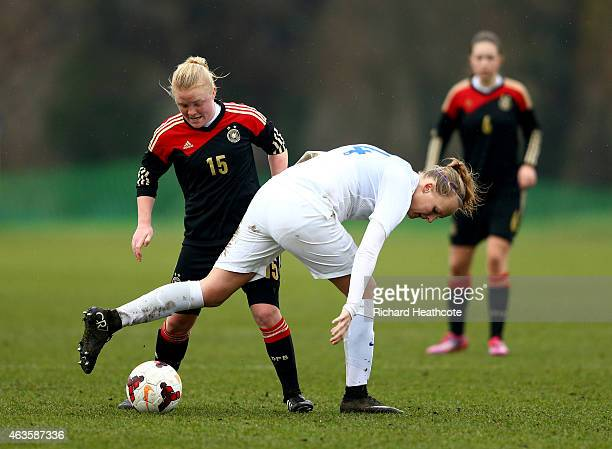Chole Peplow of England tackles Jule Dallmann of Germany during the U17 Girls International Friendly match between England and Germany at Bisham...