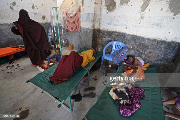 Cholerastricken victims in a former prison in the remote central Somali town of Dinsoor Cholera has now taken hold in remote areas as water sources...