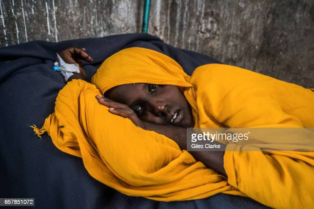 A cholerastricken woman in a former prison in Wajid Somalia Somalia is in the grip of an intense drought induced by consecutive seasons of poor...