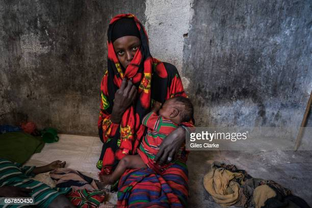 A cholerastricken woman with her children in a former prison in Wajid Somalia Somalia is in the grip of an intense drought induced by consecutive...
