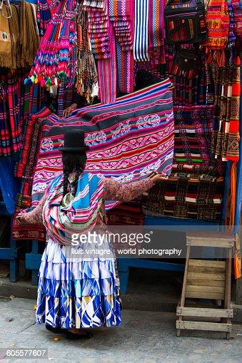 Cholita buying aguayos