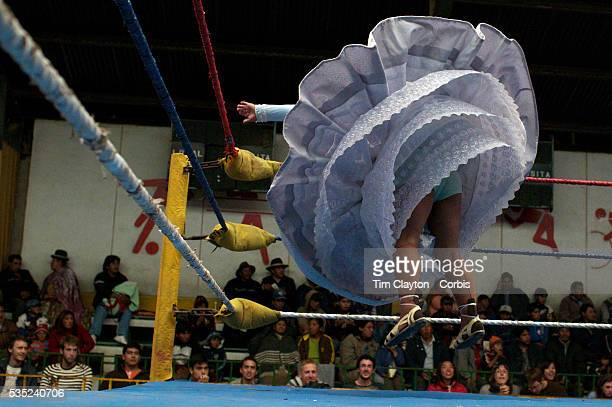 Cholita Carmen Rosa warms up before her bout during the 'Titans of the Ring' wrestling group performance at El Alto's Multifunctional Centre Bolivia...