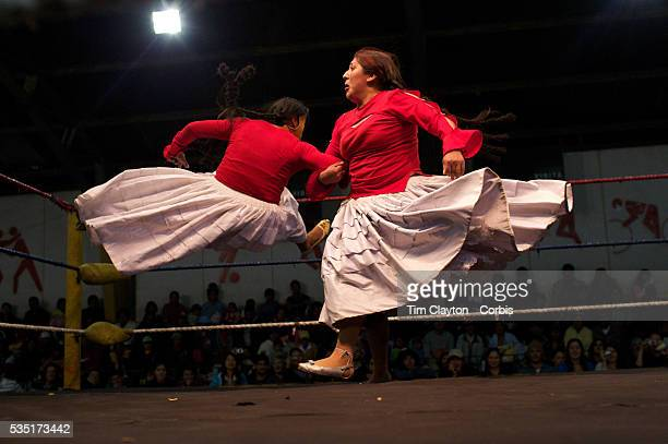 Cholita wrestler Martha La Altena fights with a male wrestler dressed as a Cholita during the 'Titans of the Ring' wrestling group's Sunday...