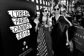 Chompoo Araya A Hargate and Sonam Kapoor meet with fan during a L'Oreal gifting event outside the Martinez Hotel during the 69th annual Cannes Film...