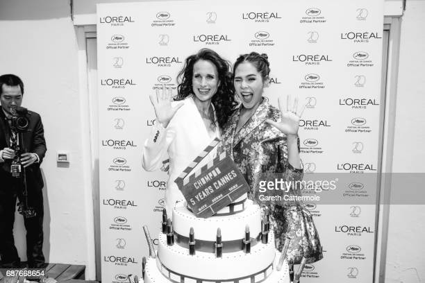Chompoo Araya is photographed with Andie MacDowell during the celebration her 5th year anniversary with L'Oreal during the Cannes film festival on...