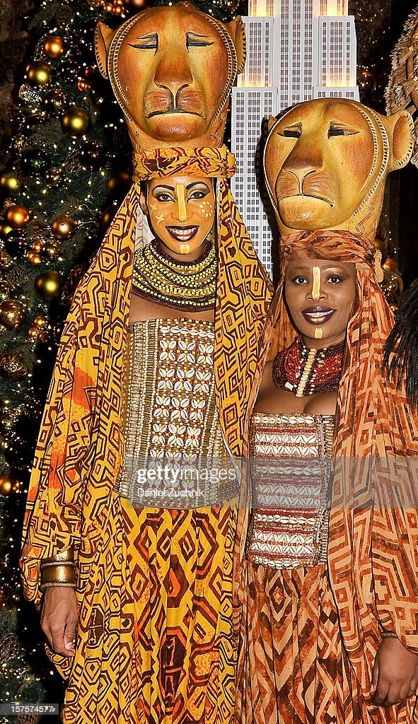 Chondra La-Tease Profit and Lindiwe Diamini attend the lighting ceremony honoring the 15th anniversary of Broadway's 'The Lion King' at the Empire State Building on December 4, 2012 in New York City.
