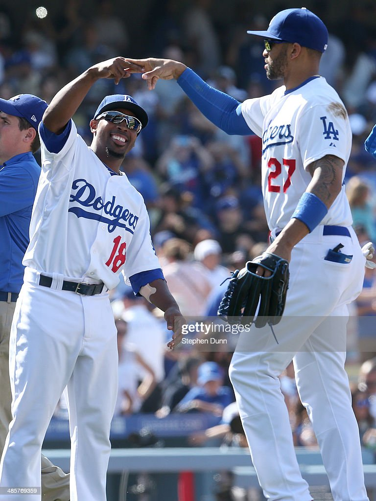 Chone Figgins #18 and Matt Kemp #27 of the Los Angeles Dodgers celebrate after the game with the Arizona Diamondbacks at Dodger Stadium on April 20, 2014 in Los Angeles, California. The Dodgers won 4-1.
