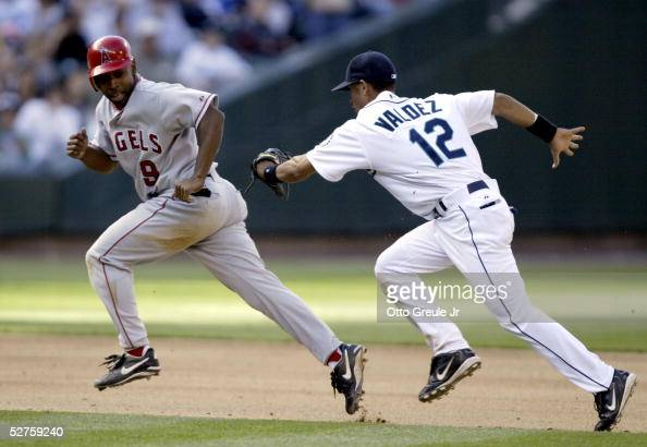 Chone Figgins of the Los Angeles Angels of Anaheim is tagged out in a rundown by Wilson Valdez of the Seattle Mariners on May 4 2005 at Safeco Field...