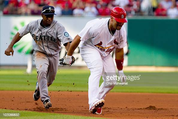 Chone Figgins of the Seattle Mariners catches Albert Pujols the St Louis Cardinals in a rundown at Busch Stadium on June 14 2010 in St Louis Missouri