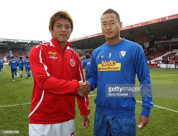 Chong Tese of Bochum and Takahito Soma of Cottbus pose before the Second Bundesliga match between FC Energie Cottbus and VfL Bochum at Stadion der...