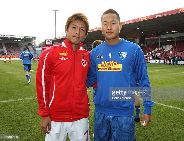Chong Tese of Bochum and Takahito Soma of Cottbus pose prior to the Second Bundesliga match between FC Energie Cottbus and VfL Bochum at Stadion der...