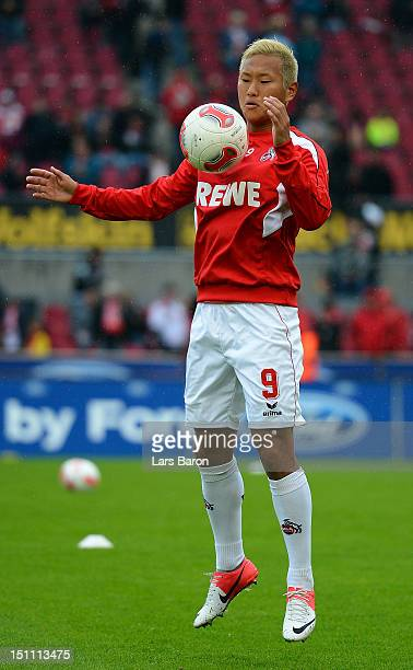 Chong Tese of Koeln warms up prior to the Second Bundesliga match between 1 FC Koeln and Energie Cottbus at RheinEnergieStadion on August 31 2012 in...