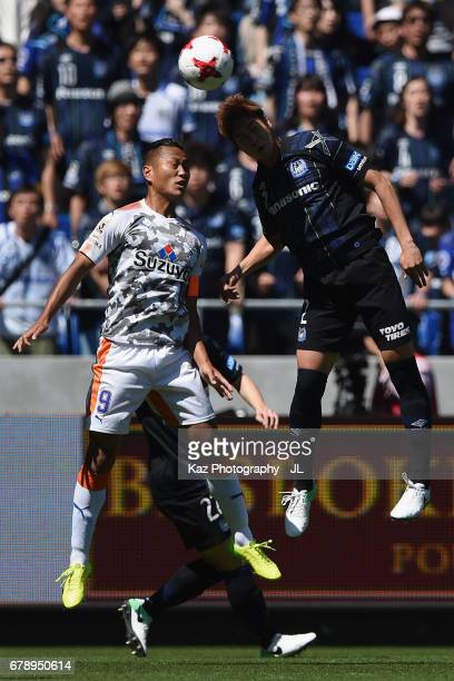 Chong Tese of Shimizu SPulse and Genta Miura of Gamba Osaka compete for the ball during the JLeague J1 match between Gamba Osaka and Shimizu SPulse...