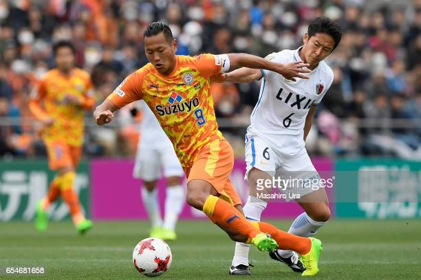 Chong Tese of Shimizu SPulse and Ryota Nagaki of Kashima Antlers compete for the ball during the JLeague J1 match between Shimizu SPulse and Kashima...