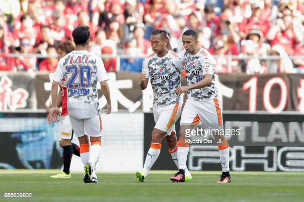 Chong Tese of Shimizu SPulse celebrates scoring his side's first goal with his team mate Tiago Alves and Ryo Takeuchi during the JLeague J1 match...