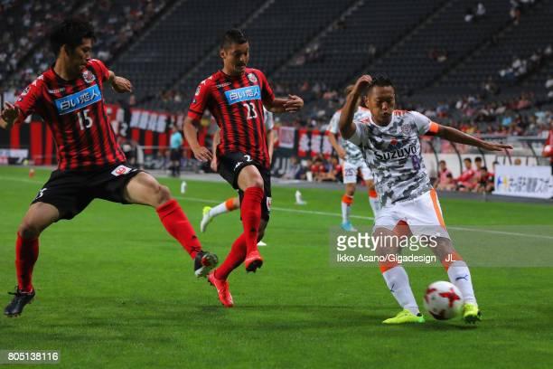 Chong Tese of Shimizu SPulse competes for the ball against Naoya Kikuchi during the JLeague J1 match between Consadole Sapporo and Shimizu SPulse at...