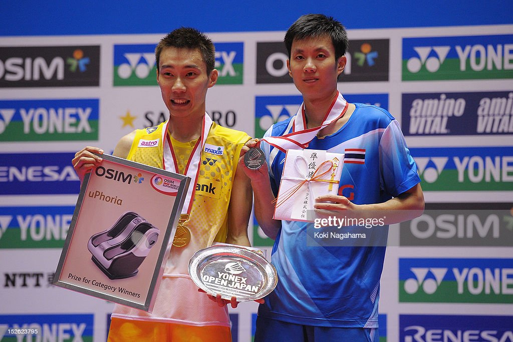 Chong Wei Lee of Malaysia and Boonsak Ponsana of Thailand pose on the podium after the Men's singles final match during day five of the Yonex Open Japan 2012 at Yoyogi Gymnasium on September 23, 2012 in Tokyo, Japan.