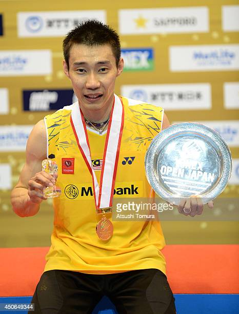 Chong Wei Lee of Malaysia celebrates with the gold medal on the podium during day six of Badminton YONEX Open on June 15 2014 in Tokyo Japan